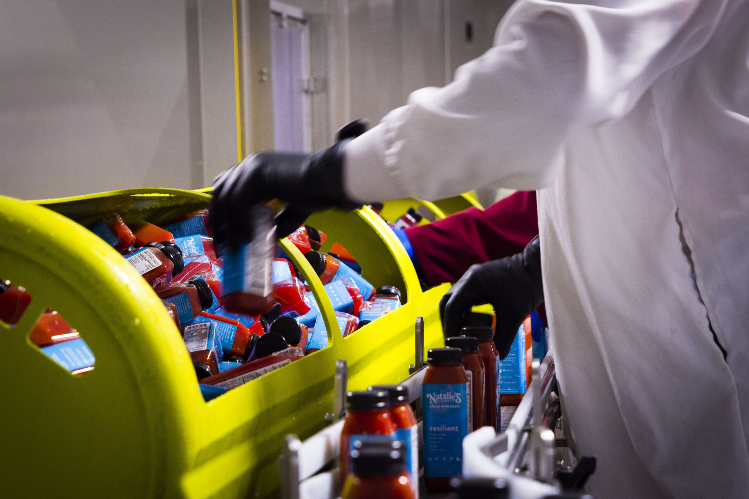 image of nutritious drinks being placed on assembly line