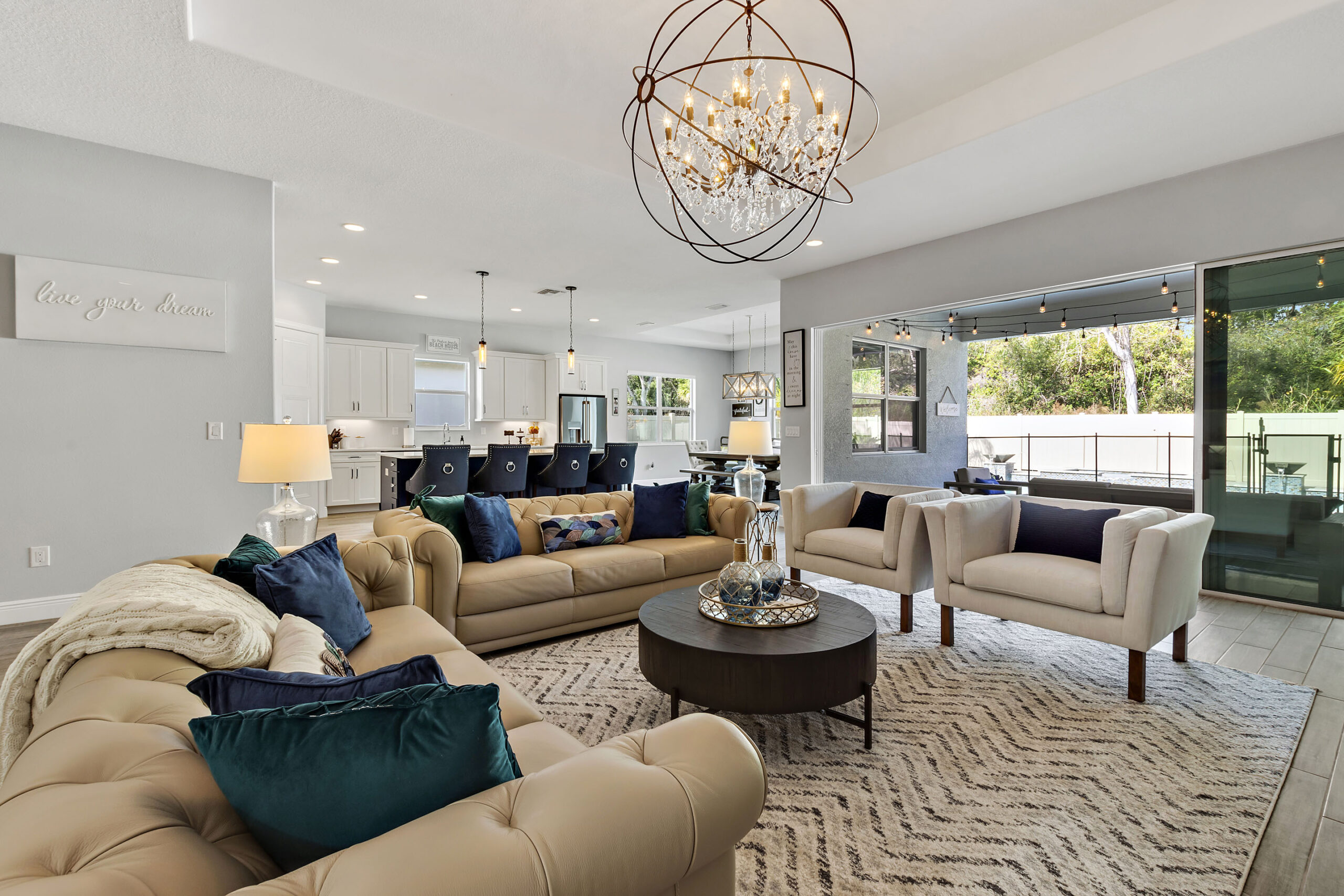 image of living room, kitchen & dining of interior decorated luxury home